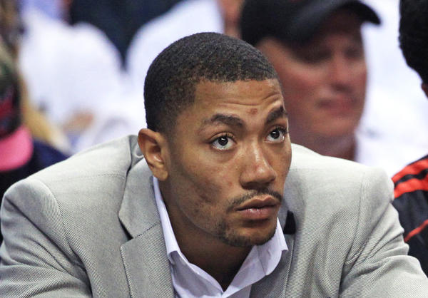 Chicago Bulls point guard Derrick Rose (1) watches the final minutes of his team's loss to the Miami Heat in game five of the Eastern Conference NBA playoffs, at the American Airlines Arena, in Miami, Florida, on May 15, 2013.