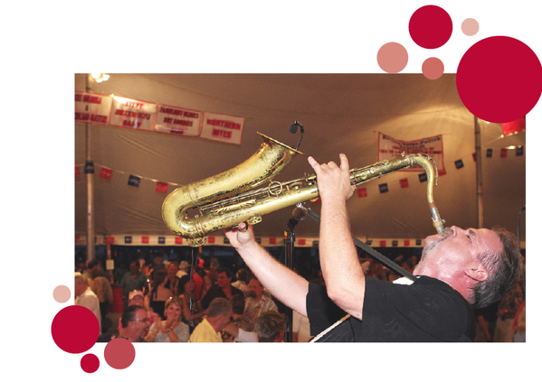 Fabulous Oldies but Goodies saxophone player Tommy Vale of Lansing, finishes a song with a big note and wins applause from a tent full of revelers at the 2012 Polish Festival in Boyne Falls.
