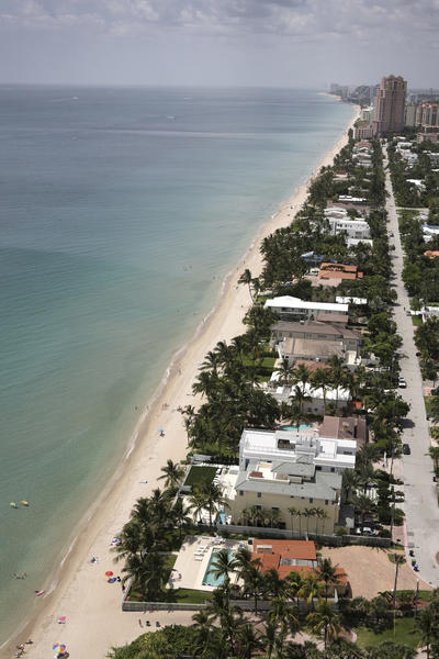 The narrow beach at high tide, looking south from a tower on the Galt Ocean Mile in Fort Lauderdale. A massive beach-widening project is planned to add at least 40 feet of beach here, as part of five miles of beach set to be widened in central and northern Broward County.