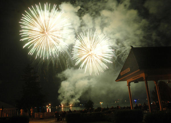 The historic Charlevoix Depot at Depot Beach is illuminated by fireworks exploding over Lake Charlevoix Friday, July 27 2012.