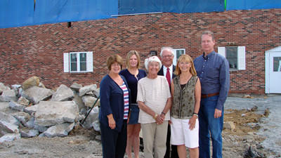 The remodeling project at Allegany College of Marylands Somerset County Campus is underway. This photograph was taken at the Somerset County Librarys former entrance. Foundation board members include, front row from left: Roberta Lohr; Peggy Ogle and Linda Fetterolf, foundation chairwoman; back row: Heidi Petrosky, college development associate; James Beener and Jon Wahl.
