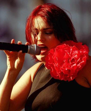 Lead singer Monique Powell from Save Ferris performs at the KROQ Weenie Roast and Fiesta in 1998.