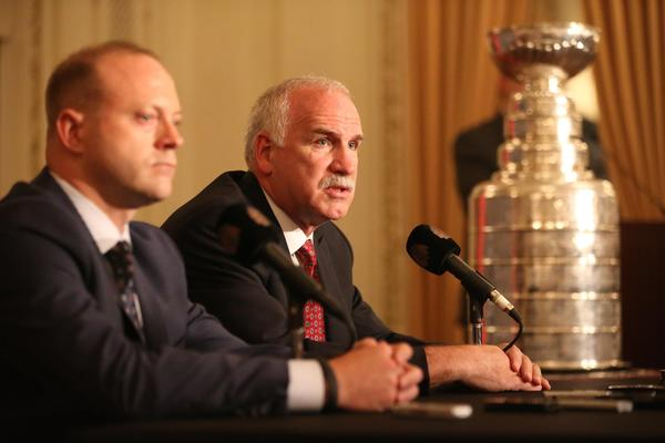 Blackhawks General Manager Stan Bowman (left) and coach Joel Quenneville answer questions during the Blackhawks Convention Friday.