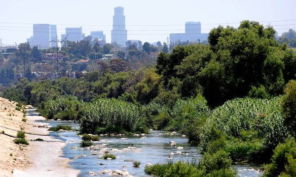 Ambitious plans to change the L.A. River, shown here leading into the downtown area, from eyesore to natural amenity depend largely on an Army Corps of Engineers study expected to be released in August.