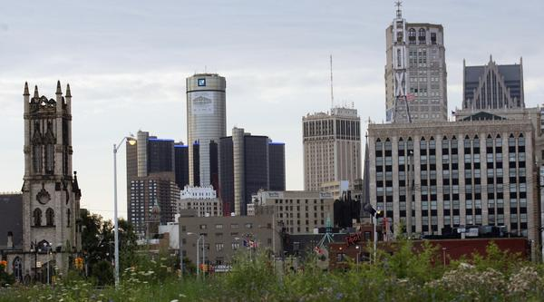 Downtown Detroit, including the General Motors World Headquarters, is pictured from a vacant lot along Woodward Avenue.