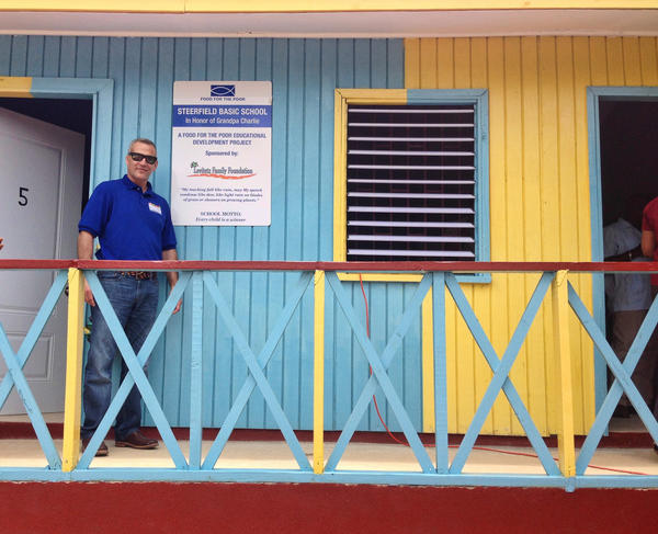 Jeff Levitetz, president of The Levitetz Family Foundation, proudly stands in front of the new Steerfield Basic School, named in honor of his grandfather, funded by the foundation and built by Food For The Poor in rural St. Ann community in Jamaica. Photo provided by Food for the Poor