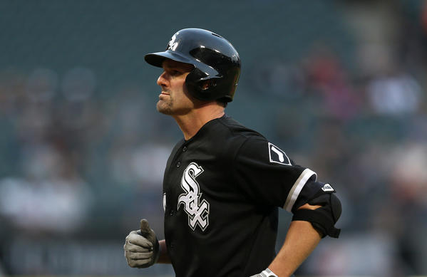 White Sox hitter Paul Konerko runs back to the dugout after flying out in the second inning against the Royals on Friday.