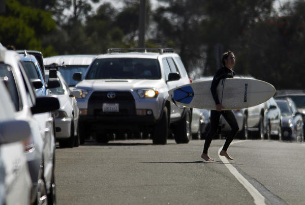 Parking is at a premium at Surfrider Beach in Malibu, an affluent community where property owners are suspected of posting scores of fake no parking signs in an effort to restrict public access to the beach.