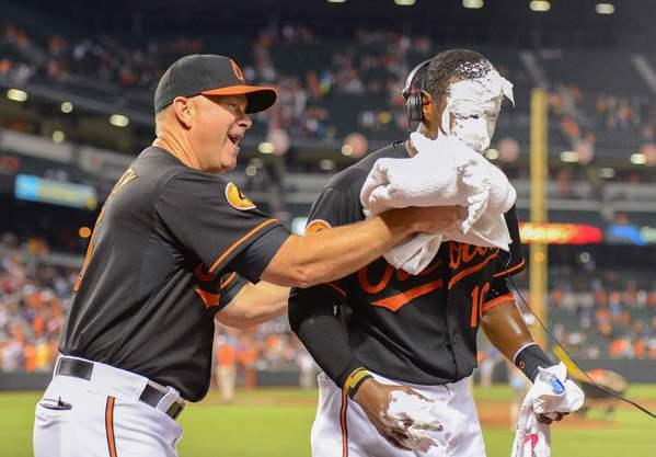 Orioles center fielder Adam Jones has a shaving cream pie thrown on him by coach Jim Presley after hitting two home runs in a 6-0 win over the Red Sox.