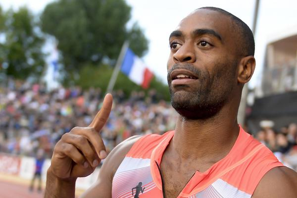 """Tyson Gay celebrates after winning the Men's 100 meter event during the Diamond League Athletics meeting """"Athletissima"""" on July, 4 in Lausanne."""