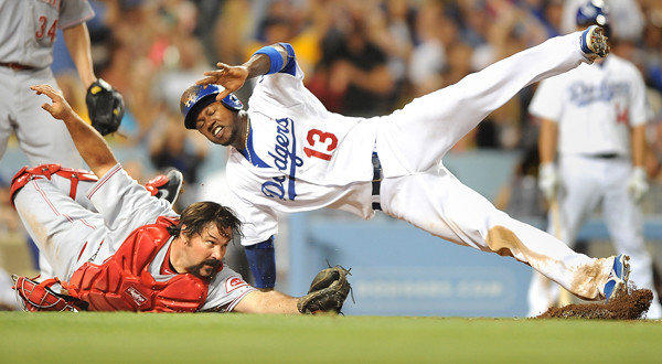 Dodgers shortstop Hanley Ramirez, right, is tagged out at home by Cincinnati Reds catcher Corky Miller during the fourth inning of the Dodgers' 2-1 win Friday.