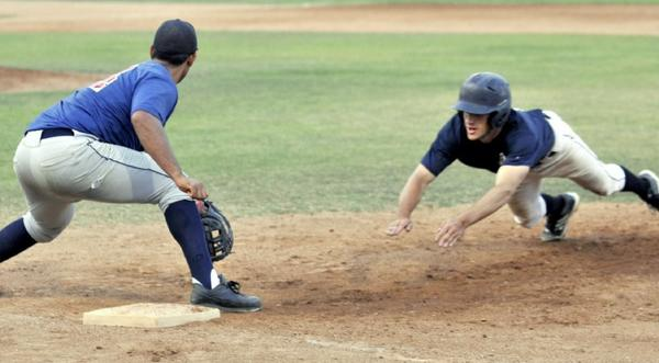 Angelenos baserunner Matthew Tellesco dives safely back to first during collegiate summer league baseball action between the Glendale Angelenos and the Montebello Stars at Stengel Field on Friday. Glendale won, 13-2. (Photo by Mike Mullen)