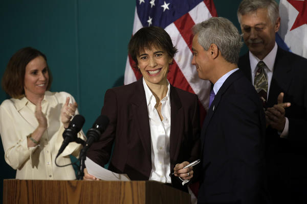 Mayor Rahm Emanuel announces Deb Mell's appointment as alderman to replace her father, Ald. Richard Mell, during a brief press conference Wednesday, July 24, 2013 at Horner Park in Chicago's 33rd ward. Deb Mell's wife, Christin Baker, is at left.