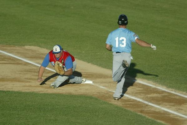 Groton first baseman Dalton Locke goes low to force out Blake Wilkinson of Webster.