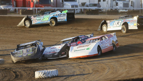 Mark Abeln, of Groton, left, Brian Diede, of Huron and David McDonald, of Huron (52x) get tied up and turned the wrong way between turns one and two as Jason Grabow, of Milbank and Steven Grabow, of Milbank (03) pass by in the background during the first heat of Late Model action Friday night at Brown County Speedway. No one was harmed in the incident and all three cars continued in the race. photo by john davis taken 7/26/2013