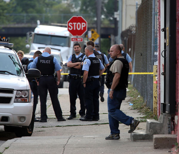 Chicago Police investigate at the scene of a shooting in the 200 block of W. Root St. in Chicago on July 26.