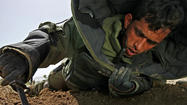 Afghanistan bomb hunters learning to shed risky habits