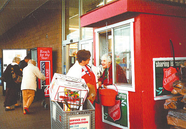 "Minnie ""Marie"" Kershner was known by many locally for the 50 years she was a bell ringer for The Salvation Army, the majority of those years at Kmart. She is greeted by an unidentified woman in this photo."