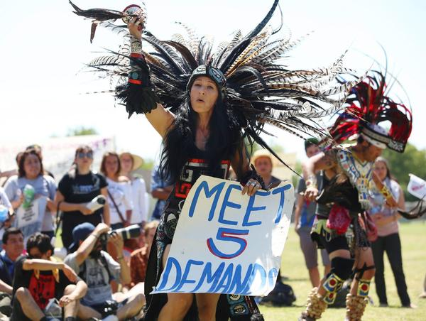 Yolanda Santoya from the Los Angeles dance group La Cuauhtemoc performs before a large group marches to California State Prison in Corcoran to support prison inmates holding a statewide hunger strike.