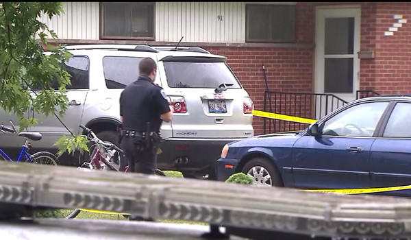 Police at the home where a woman was killed and another person stabbed Friday.