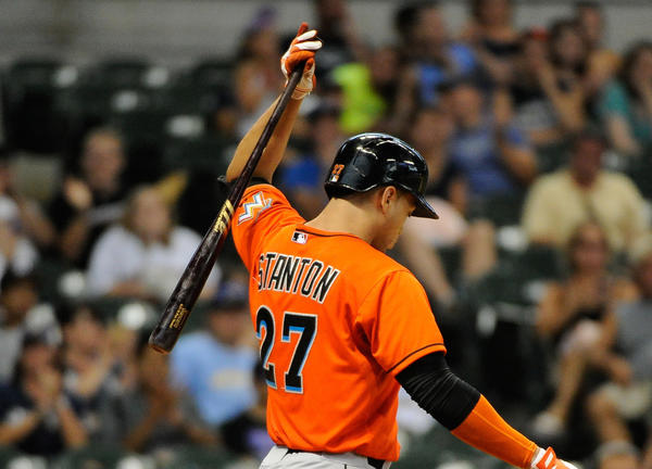 Marlins right fielder Giancarlo Stanton reacts after striking out in the 11th inning against the Brewers.