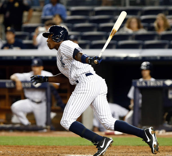Yankees left fielder Alfonso Soriano drives a run in against the Rays during the ninth inning at Yankee Stadium.