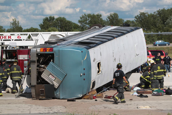 A 40 passenger bus from Colonial Hills Baptist Church carrying 40 people, mostly children and teenagers exited 465 at a high rate of speed crashing and coming to rest on the median just north of 465. (Michelle Pemberton/The Indianapolis Star)