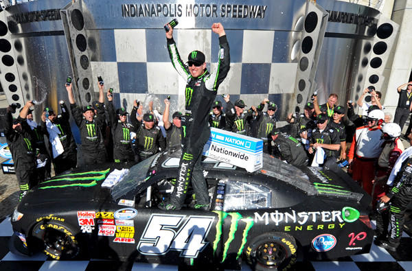 Kyle Busch celebrates after winning the NASCAR Nationwide Series Indiana 250 race at Indianapolis Motor Speedway on Saturday.