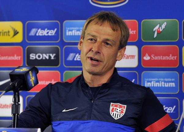 U.S. national team coach Juergen Klinsmann and player Landon Donovan hold a news conference before practice on Saturday, the day before the CONCACAF Gold Cup final against Panama at Soldier Field in Chicago.