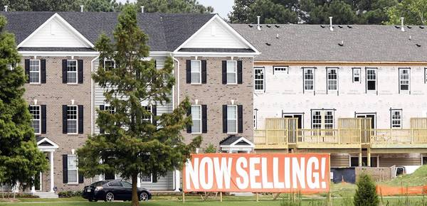 Construction is again underway at the beleaguered H2O housing development near the Hampton Coliseum.