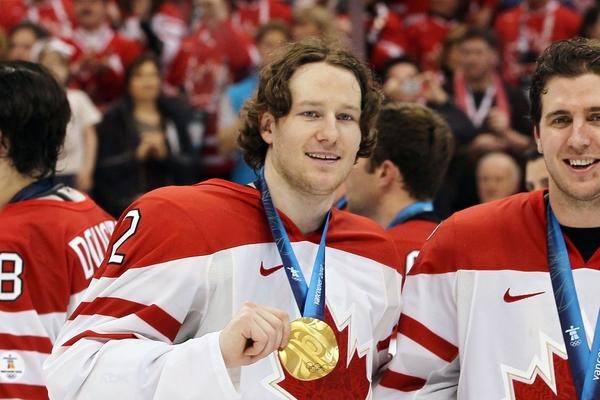 Duncan Keith and Mike Richards of Canada pose for a photo after the Canada defeated USA for the gold medal at the Vancouver Olympics.