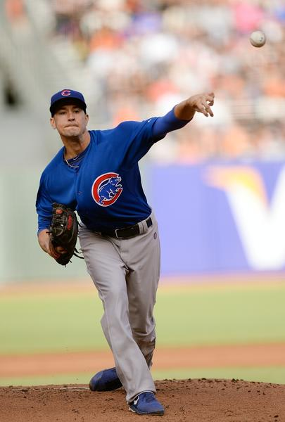 Cubs starting pitcher Chris Rusin pitches against the Giants at AT&T Park on Saturday.