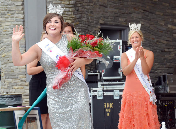 Miss Charlevoix Venetian Queen 2012 Kelsey Way (right) applauds as newly-crowned Miss Charlevoix Venetian Queen 2013 Haley Herzog waves to the crowd during Saturday's coronation ceremony in East Park.
