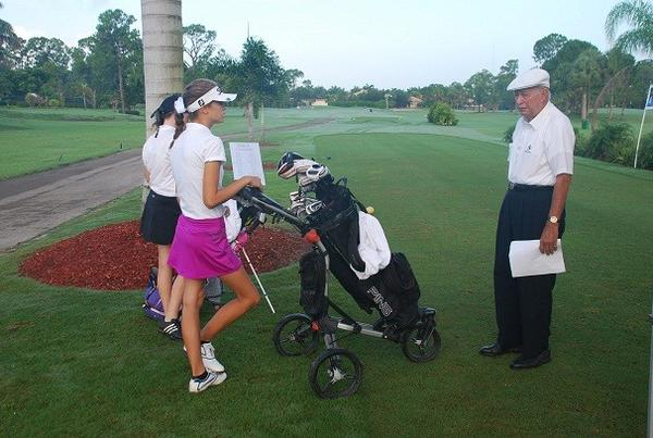Bob Toski chats with Adrianna Elliott on the first tee at the inaugural Bob Toski Junior Golf Invitational.