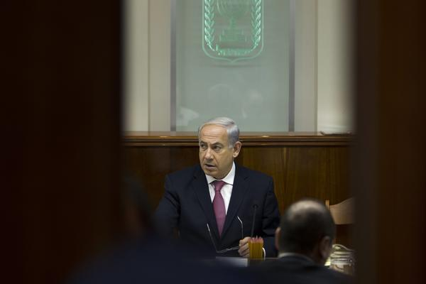 Israeli Prime Minister Benjamin Netanyahu attends the weekly cabinet meeting Sunday, during which his cabinet approved a release of Palestinian prisoners ahead of peace talks.