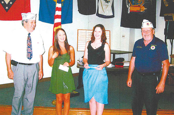 From left, AMVETS Department Commander Harold Karn, Elisabeth Sharpe, April Gearhart and Mike Mahoney.