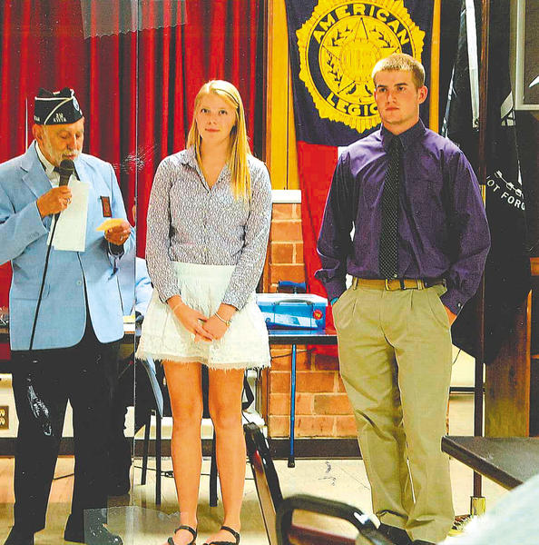 Antietam Chapter 312 of the Korean War Veterans Scholarship Chairman Joe Startari presents scholarships to Natalie Rudisill of Williamsport High School and Sean Kreps of Clear Spring High School.