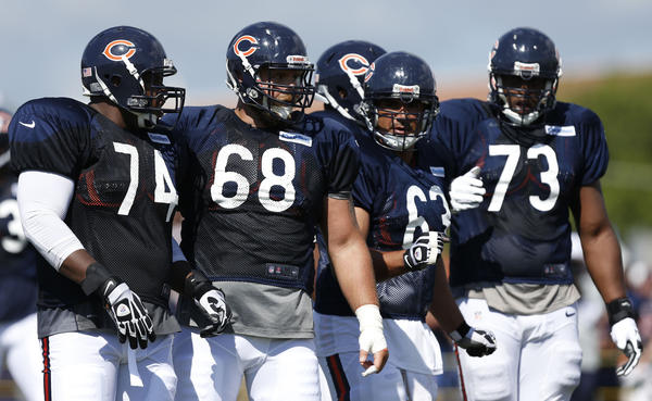Bears tackle Jermon Bushrod (left), guard Matt Slauson center Roberto Garza and tackle J'Marcus Webb line up during practice at the Bears summer camp on Sunday.