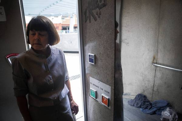 Alice Callaghan, a longtime advocate for the homeless in downtown Los Angeles, checks on the state of a public restroom on the corner of 5th and Hill Street. Callaghan has been fighting for more public restrooms for two decades.