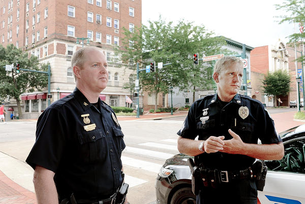 Hagerstown Police Chief Mark Holtzman, left, and Sgt. Eric Knode, keep an eye on downtown Hagerstown Tuesday morning.
