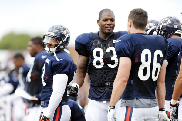 Bears tight end Martellus Bennett (83) talks with Chicago Bears tight end Kyle Adams (86) during a pause in practice at the Bears summer camp .