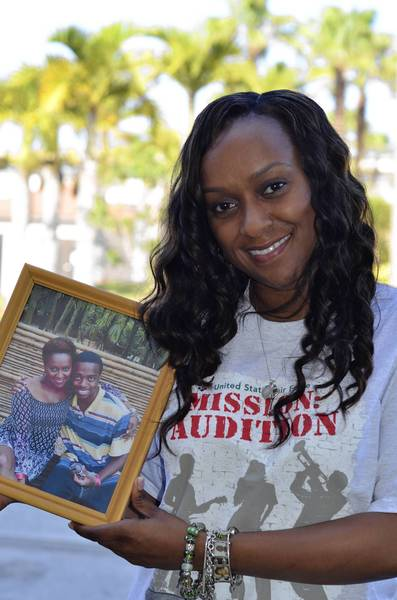 Altrameise Myers with a photo of her late son. (U.S. Air Force photo/Capt. Cathleen Snow)