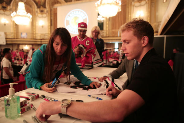 Patrick Kane signs autographs during the Blackhawks Convention.