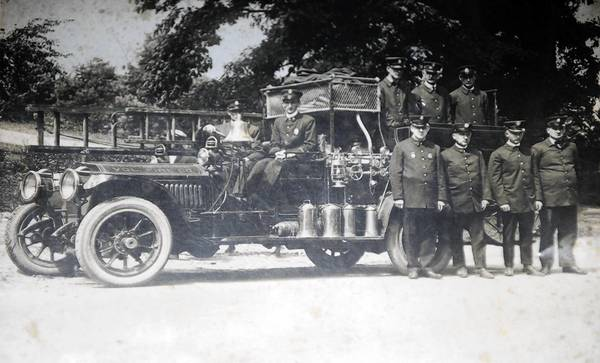 "An archival photo shows the first ""pumper"" -- jargon used to describe a fire truck that brings its own water or retrieves it from another supply source -- operated by the Reisterstown Volunteer Fire Company at their station on Main Street in Reisterstown."