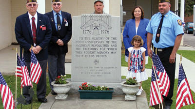 Members of the VFW Post 8826, Walker-Harris Post, Salisbury, serve the community of Salisbury and surrounding areas. Support received in return from the community makes their donations possible. From left around the 200th anniversary memorial of the American Revolution is Ken Wilson; post adjutant, Allen Broadwater; post and district quartermaster, Paul Thomas; Judge Advocate, Marcy Sebold; auxiliary president and Darren Gnagey; post commander. Lilly Wood; Buddy Poppy Queen of the post, stands in front of Sebold.
