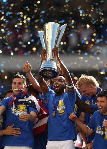 United States' DaMarcus Beasley joins his teammates in celebrating a 1-0 win over Panama during the CONCACAF Gold Cup final at Soldier Field on July 28, 2013.