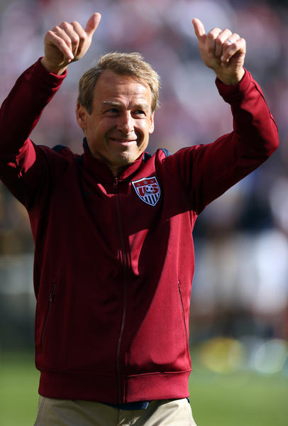 United States' coach Juergen Klinsmann walks off the field after 1-0 win over Panama in Gold Cup final at Soldier Field.