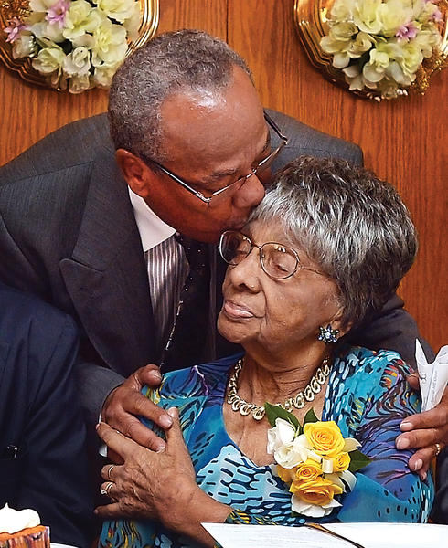 Grace M. Snively gets a hug and kiss from her pastor, the Rev. Leroy Jackson, Sunday, at her 100th birthday party. Dozens of family and friends attended a banquet in her honor at the Hagerstown Elks Lodge 278 on North Jonathan Street.