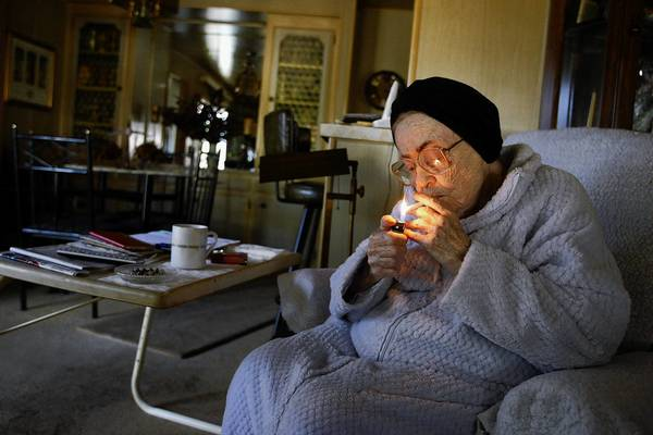 June Manning, 84, lights up. If anti-smokers have their way, she'll pay more for a pack of cigarettes.
