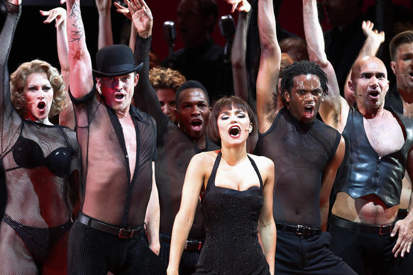 "Samantha Barks, center, as Velma Kelly in the Los Angeles Philharmonic's performance of the musical ""Chicago,"" directed by Brooke Shields, with musical director and conductor Rob Fisher at the Hollywood Bowl."